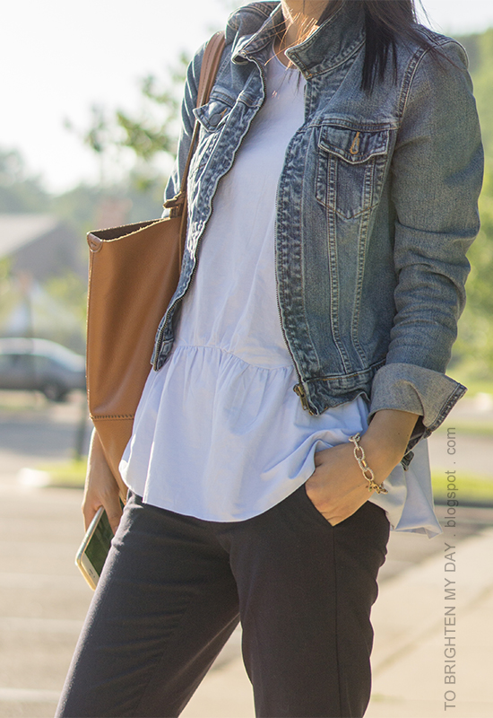 denim jacket, baby blue peplum top, cognac brown tote, navy pants