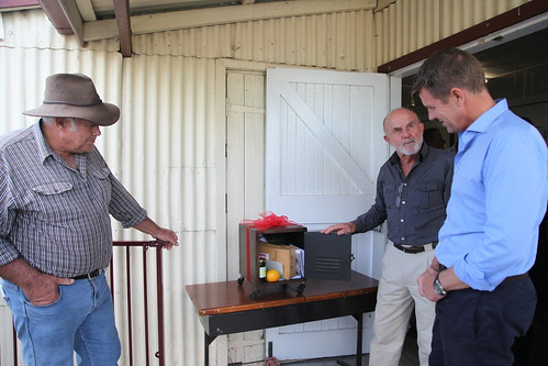 Kevin Taggart (Wonnarua traditional custodian) and John Krey (Bulga resident) give Premier Mike Baird a time capsule of local items including wine and honey