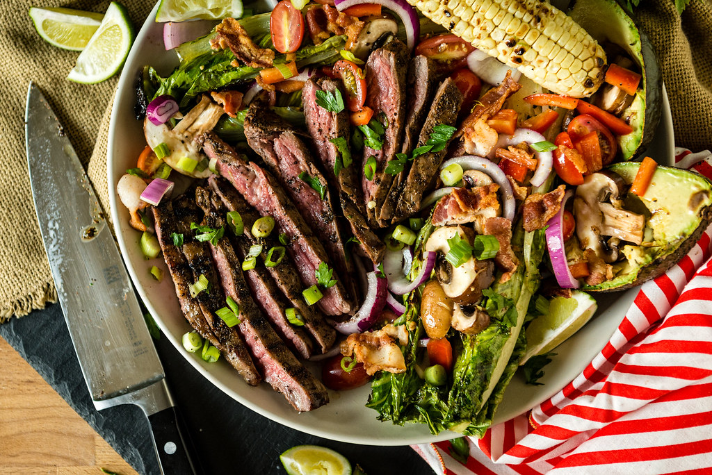 Grilled Coffee Crusted Flank Steak Salad - the perfect light summer salad for grill enthusiasts! Recipe at GirlCarnivore.com