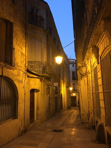 Montpellier lit alleyway at night