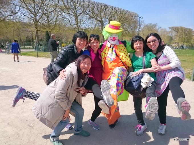 Eiffel Tower area photos with a clown