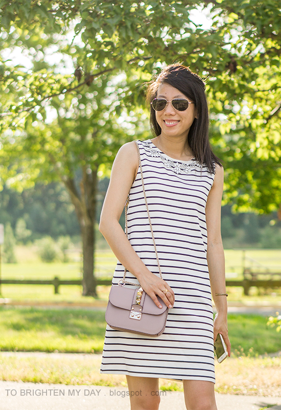 striped shift dress with jewels, gold jewelry, nude bag