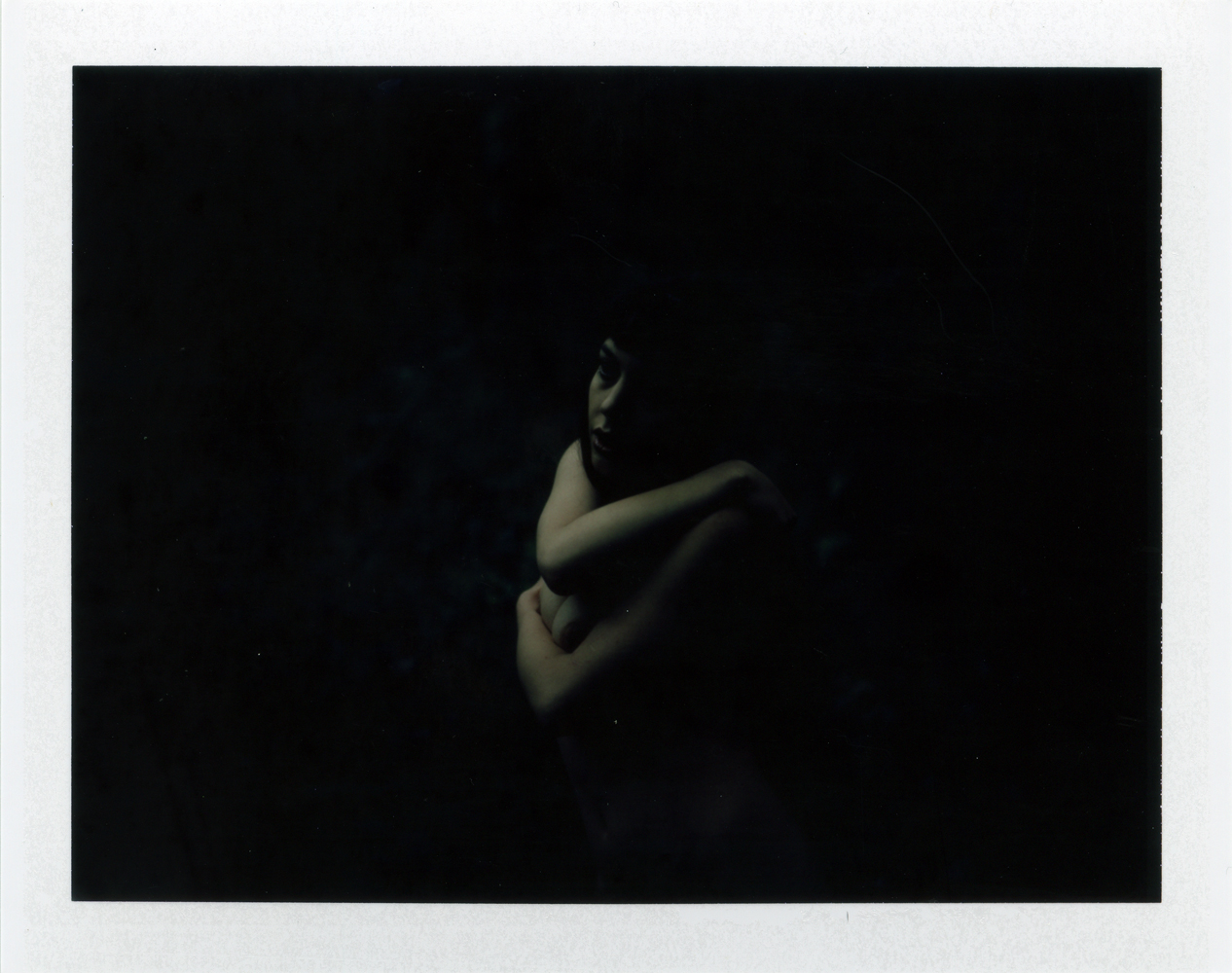 Gestalta photographed by Selina Mayer. Colour polaroid artistic nude image shot in the forest