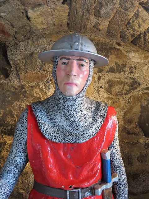A guard at the medieval castle of Carrickfergus along the Coastal Causeway Route of Ireland, UK