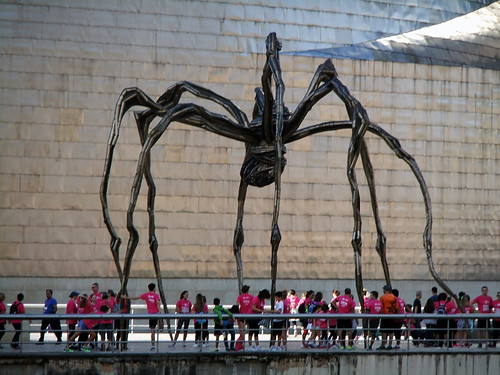 The giant 'spider' sculpture in front of Frank Gehry's architectural masterpiece, the Guggenheim modern art museum in Bilbao, Spain
