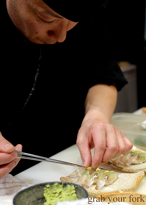 Sushi chef Tomoyuki Matsuya adding ginger to sand whiting at Hana Ju-Rin in Crows Nest Sydney