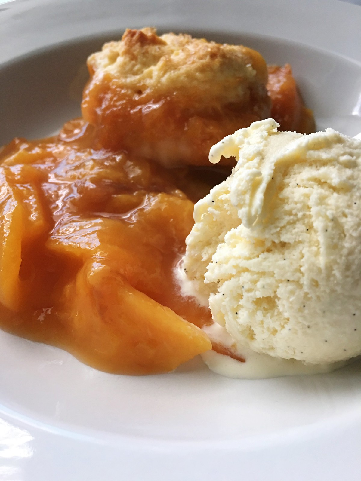 Old Fashioned Peach Cobbler from Kitchen in the Hills. This is a classic southern recipe that's simple to make and perfectly delicious!