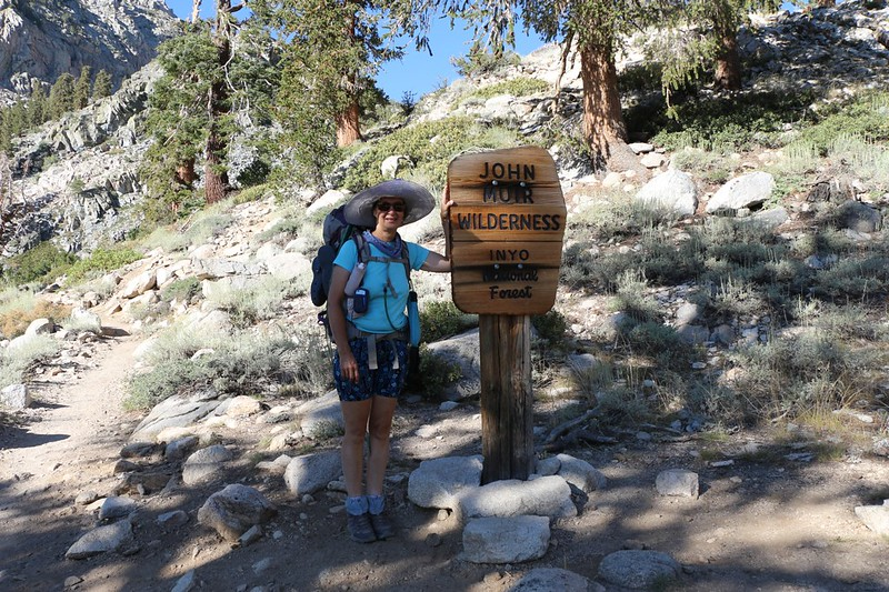 Vicki posing at the John Muir Wilderness boundary sign